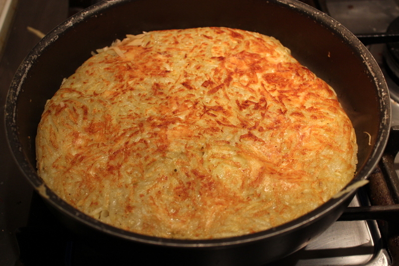 Cooked stuffed rosti in the pan