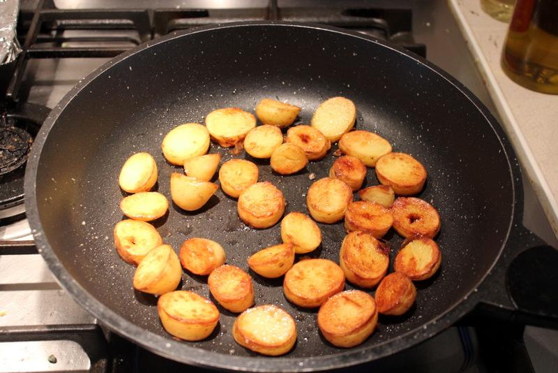Potatoes frying in duck fat