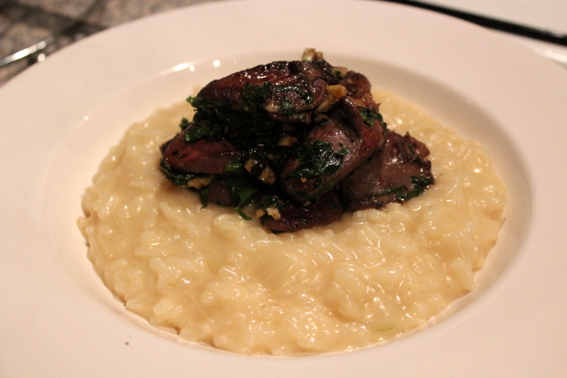 Duck Hearts with garlic & parsley on parmesan risotto